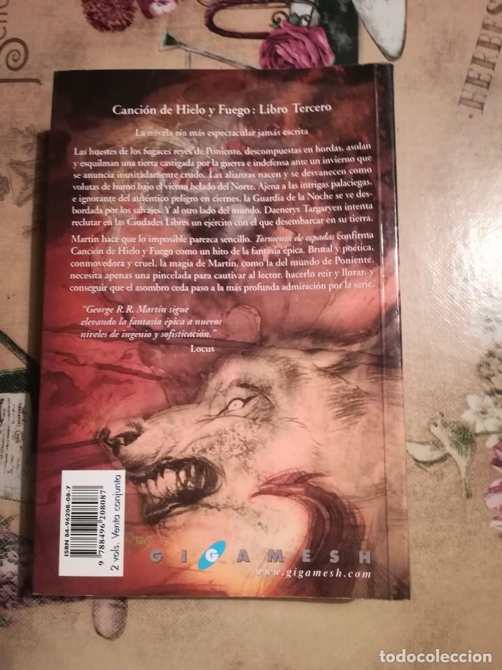 Libros de segunda mano: Tormenta de espadas II. Canción de hielo y fuego 3 - George R.R. Martin - Foto 2 - 126482887