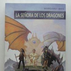 Libros de segunda mano: LA SEÑORA DE LOS DRAGONES - MARGARET WEIS - ED. DEVIR - 2004. Lote 130796332