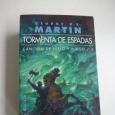 Libros de segunda mano: CANCIÓN DE HIELO Y FUEGO 3. TORMENTA DE ESPADAS.GEORGE R.R. MARTIN. EDICIÓN DE BOLSILLO. NUEVO. Lote 187406151