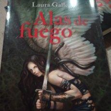 Libros de segunda mano: ALAS DE FUEGO. GALLEGO GARCÍA, LAURA. MINOTAURO, 2016. FANTASIA.LIBRO NUEVO. Lote 268472054
