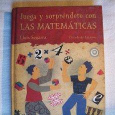 Libros de segunda mano de Ciencias: JUEGA Y SORPRÉNDETE CON LAS MATEMÁTICAS. LLUIS SEGARRA. Lote 26269329