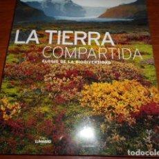 Libros de segunda mano: LA TIERRA COMPARTIDA,ELOGIO DE LA BIODIVERSIDAD / LUNWERG EDITORES. Lote 188432251