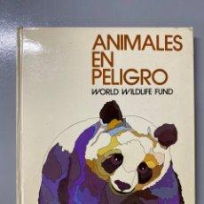 Libros de segunda mano: LIBRO. ANIMALES EN PELIGRO. WORLD WILDLIFE FUND. SALVAT. NAVARRA. Lote 228810300
