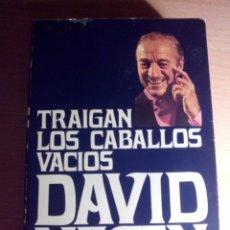Libros de segunda mano: LIBRO. TRAIGAN LOS CABALLOS VACÍOS. DAVID NIVEN. EDITORIAL NOGUER. 1ª EDICIÓN. 1976.. Lote 102971919