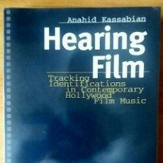 Libros de segunda mano: HEARING FILM. TRACKING IDENTIFICATIONS IN CONTEMPORARY HOLLYWOOD FILM MUSIC. ANAHID KASSABIAN.. Lote 153454374