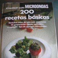 Libros de segunda mano: COCINAR CON MICROONDAS. 200 RECETAS BASICAS. Lote 27444902