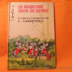 Libros de segunda mano: LOS TRES MOSQUETEROS CONTRA LOS CASTORES. 3 CUENTOS ILUSTRADOS POR C. GARMENDIA. CUENTOS JILGUERO SE. Lote 34147842