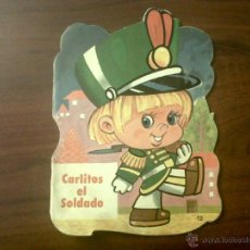 Libros de segunda mano: CARLITOS EL SOLDADO-EDITORIAL VASCO AMERICANA 1979-SERIE TROQUELADOS EVA. Lote 40672268
