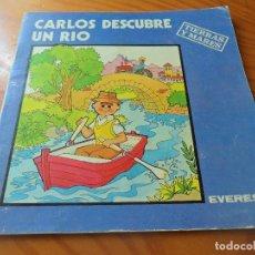 Libros de segunda mano: CARLOS DESCUBRE UN RIO -COLECCION CARLOS Y SANDRA Nº 8 - ED. EVEREST 1982 - TIERRAS Y MARES. Lote 88146872