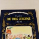 Libros de segunda mano: EL CUENTO DE TRES CERDITOS Y OTROS MÁS - BIBLIOTECA ORO DE LOS CUENTOS - ILUSTRACIONES: TONY WOLF. Lote 95836371