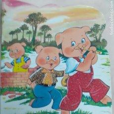 Libros de segunda mano: CUENTO: LOS TRES CERDITOS ILUSTRADO POR JULI AÑO 1983. Lote 170522289