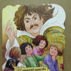 Libros de segunda mano: CUENTO TROQUELADO EN CATALA EL GEGANT EGOISTA COMBEL 2002. Lote 184063917