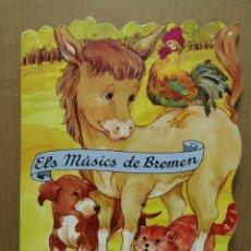 Libros de segunda mano: CUENTO TROQUELADO EN CATALA ELS MUSIC'S DE BREMEN COMBEL 1997. Lote 184063975