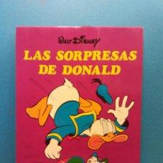 Libros de segunda mano: LAS SORPRESAS DE DONALD. WALT DISNEY. EDICIONES SUSAETA S.A.. Lote 195490761