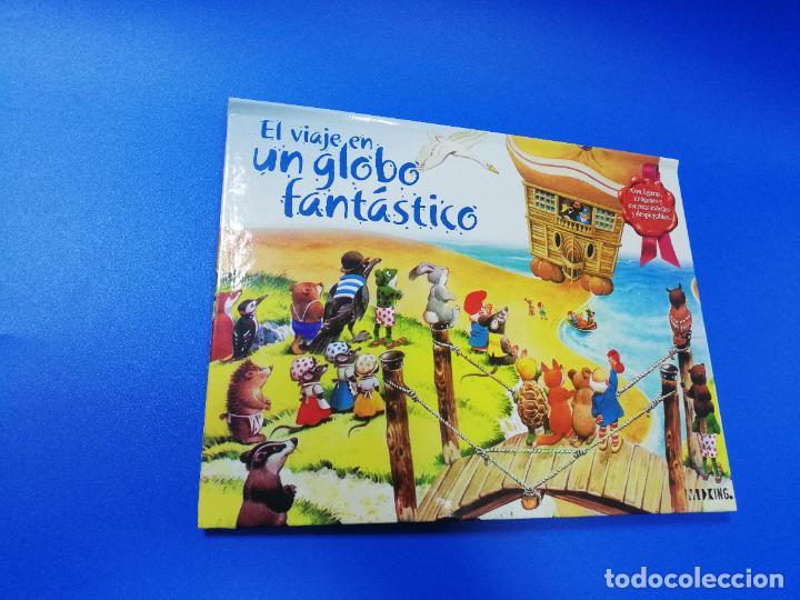 Libros de segunda mano: EL VIAJE EN UN GLOBO FANTASTICO. CUENTO TROQUELADO A COLOR. LICENCIA EDITORIAL 2001. VER FOTOS. - Foto 2 - 248721245