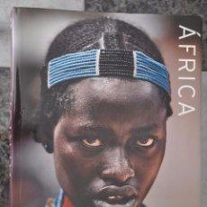 Libros de segunda mano: AFRICA POR STEVE BLOOM , EN ESPAÑOL , LUNWERG , AÑO 2008. Lote 90515615