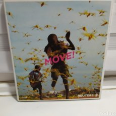 Libros de segunda mano: MOVE REUTERS , FOTOGRAFIAS 2005. Lote 179052648