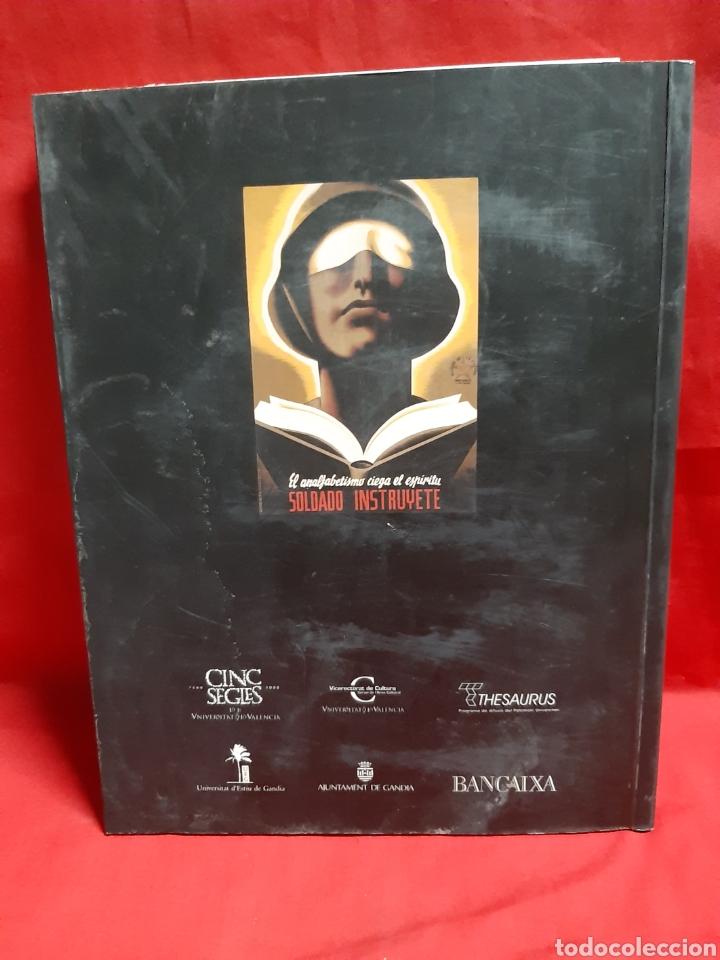 Libros de segunda mano: ART I PROPAGANDA. Cartells de la Universitat de Valencia publ . de la Univ Valencia 2001 en buen est - Foto 3 - 195335546