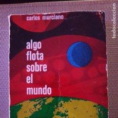Libros de segunda mano: ALGO FLOTA SOBRE EL MUNDO DE CARLOS MURCIANO - OVNIS - RARO Y DIFICIL DE ENCONTRAR. Lote 94518374
