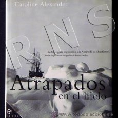 Libros de segunda mano: ATRAPADOS EN EL HIELO LIBRO SHACKLETON ANTÁRTIDA POLO SUR VIAJE AVENTURA FOTOGRAFÍA BARCO MAR OCÉANO. Lote 26156210