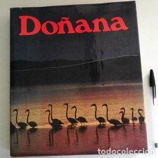 Libros de segunda mano: DOÑANA LIBRO NATURALEZA FOTOS DEL PARQUE NACIONAL - ANDALUCÍA ESPAÑA FOTOGRAFÍA FAUNA VIAJE HISTORIA. Lote 101479687