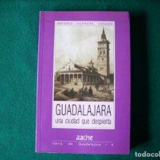 Libros de segunda mano: GUADALAJARA -UNA CIUDAD QUE DESPIERTA - ANTONIO HERRERA CASADO - AACHE EDICIONES - AÑO 1997. Lote 133100210