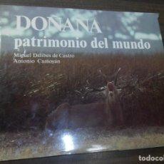 Libros de segunda mano: DOÑANA PATRIMONIO DEL MUNDO. MIGUEL DELIBES CASTRO. ANTONIO CAMOYAN. 1981.. Lote 163355222