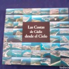 Libros de segunda mano: LAS COSTAS DE CADIZ DESDE EL CIELO, POSTALES DEL LITORAL GADITANO, ESTADO EXCELENTE. Lote 295279558