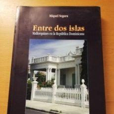 Libros de segunda mano: ENTRE DOS ISLAS. MALLORQUINES EN LA REPÚBLICA DOMINICANA (MIQUEL SEGURA). Lote 179518235