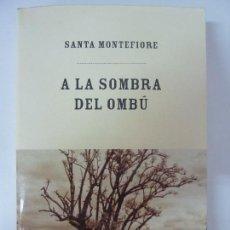 Libros de segunda mano: A LA SOMBRA DEL OMBÚ. SANTA MONTEFIORE. 1ª EDICIÓN. Lote 86346004