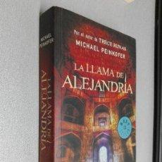 Libros de segunda mano: LA LLAMA DE ALEJANDRÍA / MICHAEL PEINKOFER / DEBOLSILLO 1ª EDICIÓN 2010. Lote 98782283