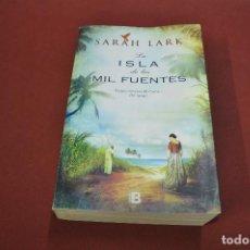Libros de segunda mano: LA ISLA DE LAS MIL FUENTES - SARAH LARK - NOB. Lote 100155503