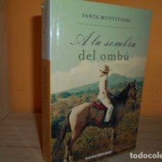 Libros de segunda mano: A LA SOMBRA DEL OMBU / SANTA MONTEFIORE. Lote 173460333