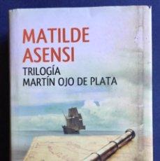 Libros de segunda mano: TRILOGÍA MARTÍN OJO DE PLATA - MATILDE ASENSI TAPA DURA SOBRECUBIERTA PLANETA 2014. Lote 194984675