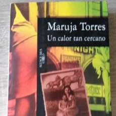 Libros de segunda mano: UN CALOR TAN CERCANO ** MARUJA TORRES. Lote 195167250