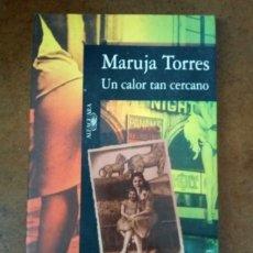 Libros de segunda mano: UN CALOR TAN CERCANO (MARUJA TORRES) ALFAGUARA. Lote 221719656