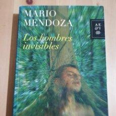 Libros de segunda mano: LOS HOMBRES INVISIBLES (MARIO MENDOZA). Lote 234772130