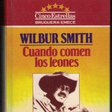 Libros de segunda mano: WILBUR SMITH - CUANDO COMEN LOS LEONES. Lote 237589945