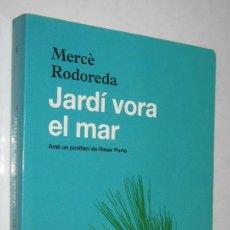 Libros de segunda mano: JARDI VORA EL MAR - MERCE RODOREDA - EN CATALAN. Lote 244573390