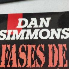 Libros de segunda mano: FASES DE GRAVEDAD. DAN SIMMONS.. Lote 264538914