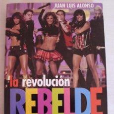 Libros de segunda mano: LA REVOLUCION REBELDE INCLUYE DVD Y FOTOS ALBUM CENTRAL JUAN LUIS ALONSO. Lote 98045415