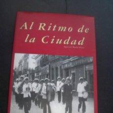 Libros de segunda mano: AL RITMO DE LA CIUDAD AGUSTIN MEDEL HISTORIA DE LA BANDA MUSICA MUNICIPAL DE HUELVA. Lote 145239622