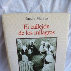 Libros de segunda mano: EL CALLEJON DE LOS MILAGROS-NAGUIB MAHFUZ-. Lote 25619696