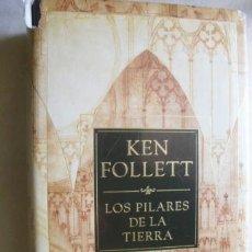 Libros de segunda mano: LOS PILARES DE LA TIERRA. FOLLET, KEN. 2006. Lote 38075785