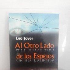 Libros de segunda mano: AL OTRO LADO DE LOS ESPEJOS. LEE JOVER. Lote 118435695