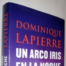 Libros de segunda mano: UN ARCO IRIS EN LA NOCHE - DOMINIQUE LAPIERRE - ENE. Lote 147577298