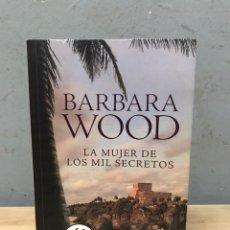 Libros de segunda mano: LA MUJER DE LOS MIL SECRETOS POR BARBARA WOOD. Lote 192801936
