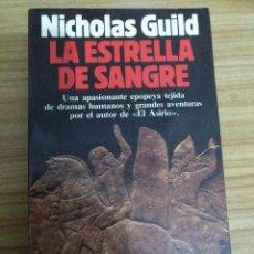 Libros de segunda mano: LA ESTRELLA DE SANGRE (NICHOLAS GUILD) 1ª EDICIÓN. Lote 195154991