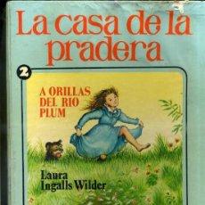 Libros de segunda mano: LAURA INGALLS WILDER : LA CASA DE LA PRADERA Nº 2 -A ORILLAS DEL RÍO PLUM (BRUGUERA, 1977). Lote 90841089