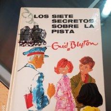 Libros de segunda mano: LOS SIETE SECRETOS SOBRE LA PISTA - ENID BLYTON - EDITORIAL JUVENTUD. Lote 183313375